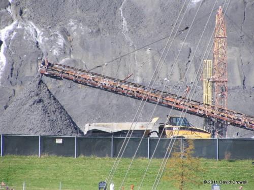 Coal ash hill in front of coal ash mountain
