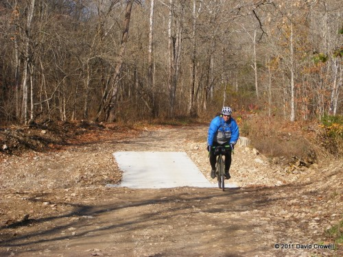 Tim and the paved, dry, creek crossing
