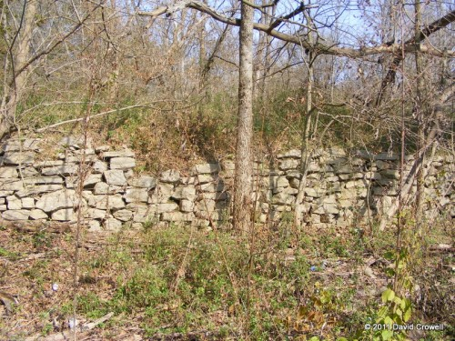 Rock wall next to roadbed